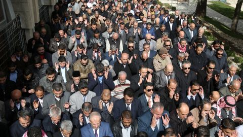 Muslims pray in the streets of Amman on February 4.