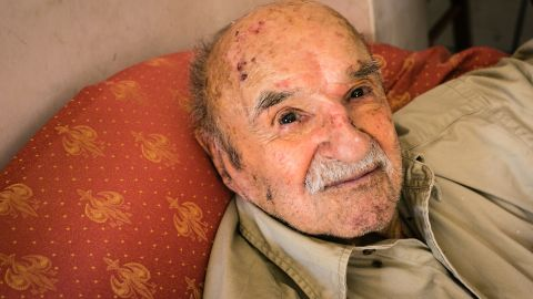 """Konstantinos Spanos, 101, says the key to long life is modesty in everything, including """"food, women and entertainment."""" He reads five hours a day."""
