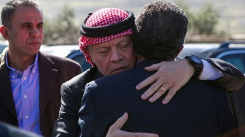 Jordan's King Abdullah II, center, greets a relative of al-Kasasbeh's while paying his condolences on Thursday, February 5.