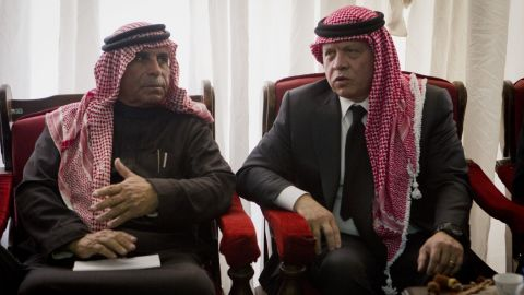 Jordanian King Abdullah II, right, talks with Safi al-Kasasbeh, father of slain Jordanian pilot, Lt. Moath al-Kasasbeh, on February 5.