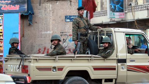 Yemeni soldiers guard the presidential palace in Sanaa on Friday, February 6.