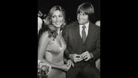 """Linda Thompson, who became Jenner's second wife, accompanies Jenner at the New York premiere of the movie """"Can't Stop the Music"""" in June 1980. Jenner appeared in the movie, which was a huge dud and won the first Razzie award for worst picture."""