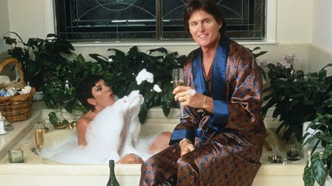 The Jenners share a bottle of champagne over a bubble bath.