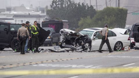 Members of the Los Angeles County Sheriff's Department work the wreck scene. Jenner was the driver of one vehicle, Deputy Ray Hicks told CNN.<br />