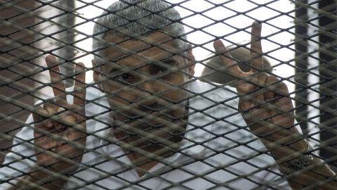 File: Al-Jazeera journalist Mohamed Fahmy, pictured under detention in June 2014, is suing the network for $100 million.