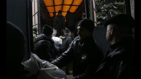 Residents unload humanitarian aid in Debaltseve on Friday, February 6.