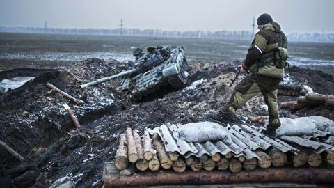 A pro-Russian rebel guards a captured former Ukrainian Army checkpoint outside Vuhlehirsk on Thursday, February 5.