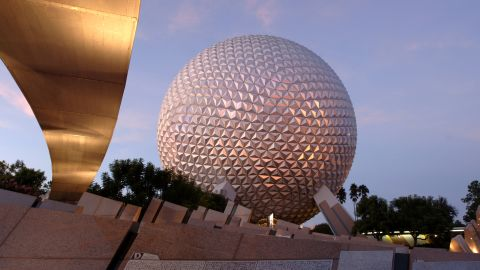 """EPCOT'S SHINING ICON - Spaceship Earth is the visual and thematic centerpiece of Epcot at Walt Disney World Resort in Lake Buena Vista, Fla. The geodesic dome weighs 16 million pounds and the outer """"skin"""" of Spaceship Earth is made up of 11,324 aluminum and plastic-alloy triangles. The attraction inside Spaceship Earth presented by Siemens includes a time-travel adventure through the history of communication, showing how the spirit of innovation has moved people from the caves to the cosmos. (Gene Duncan, photographer)"""