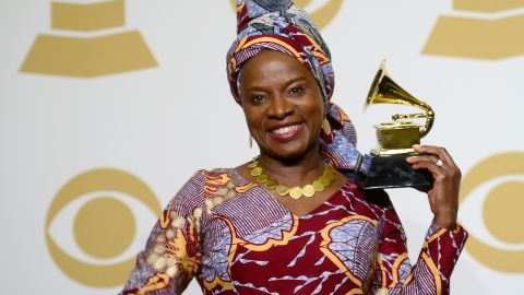 """Angelique Kidjo celebrates her win for """"Best World Music Album"""" at the 57th Annual Grammy Awards at the Staples Center on February 8, 2015 in Los Angeles, California."""