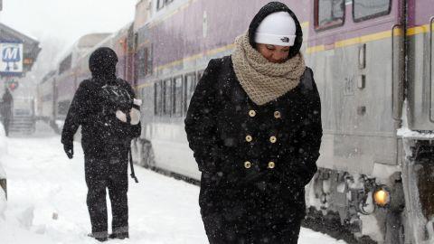 Passengers wait at the commuter rail train station in Framingham on February 9.