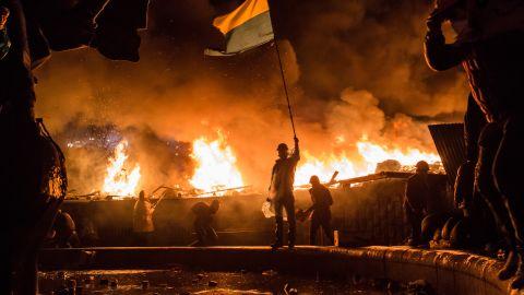 Anti-government protesters guard the perimeter of Maidan Square on February 19, 2014 in Kiev, Ukraine.
