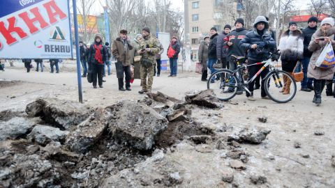 People examine a crater after shelling in eastern Ukrainian town of Kramatorsk, in the Donetsk region, on February 10, 2015. At least six civilians were killed and 21 wounded in a rocket attack on Ukraine's military headquarters in the war-torn east, local authorities said. The attack also hit residential areas of Kramatorsk, which is considered to be under firm Kiev control. AFP PHOTO / SERGEY BOBOKSERGEY BOBOK/AFP/Getty Images