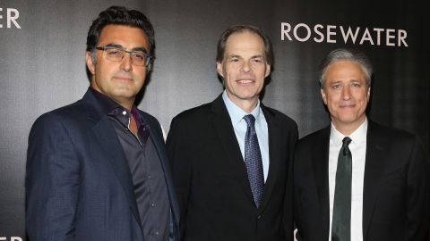 """In 2013, Stewart took a 12-week hiatus from """"The Daily Show"""" to make the film """"Rosewater,"""" his directorial debut. Released in 2014, the movie tells the story of journalist Maziar Bahari, far left with Tom Ortenberg and Stewart, and his 2009 imprisonment in Iran."""