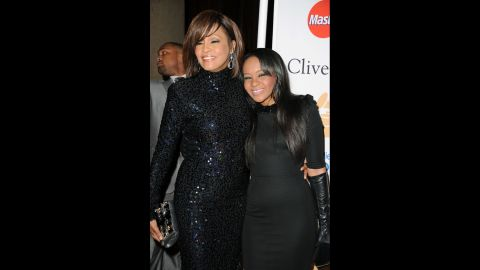 Houston and her daughter, Bobbi Kristina Brown, arrive at a gala event honoring David Geffen in February 2011.