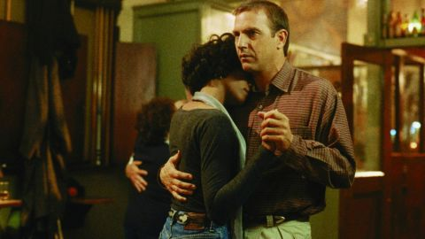 """Houston dances with Kevin Costner in a scene from the 1992 film """"The Bodyguard."""""""