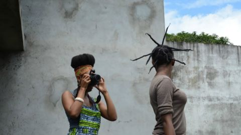 """American transplant Bibi Gnagno moved to the Ivory Coast and became fascinated with Coastians attitudes towards hair. She is working on a documentary on the subject called """"Is that (all) your hair?"""""""