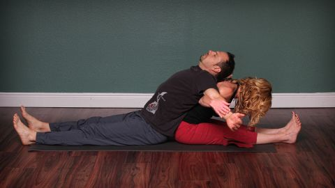 This position lengthens lower-back and hamstrings, alternately opens chest and front of shoulders