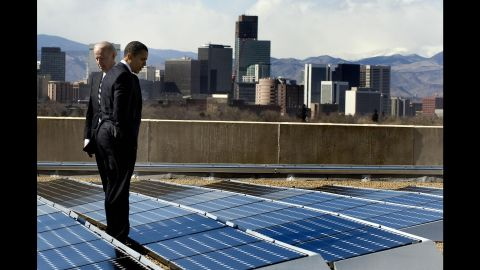 Obama and Vice President Joe Biden look at solar panels as they tour the solar array at the Denver Museum of Nature and Science on February 17, 2009. That same day, Obama signed the American Recovery and Reinvestment Act.