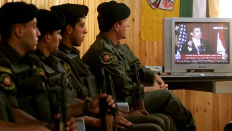 """Palestinian security forces in Jenin, West Bank, listen to Obama speak from Cairo University in Egypt in June 2009. The Palestinian Authority hailed as a """"good beginning"""" Obama's speech to the Muslim world in which he reiterated his support for a Palestinian state."""