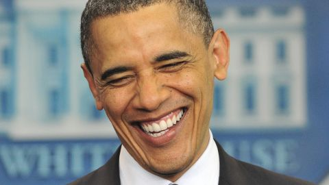 """Obama laughs as he makes a statement on his birth certificate in April 2011. Obama said he was amused over conspiracy theories about his birthplace, and he said the media's obsession with the """"sideshow"""" issue was a distraction in a """"serious time."""""""