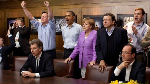 British Prime Minister David Cameron, Obama, German Chancellor Angela Merkel and others watch the overtime shootout of the Champions League final between Chelsea and Bayern Munich in a conference room at Camp David, Maryland, during a G-8 Summit in May 2012.