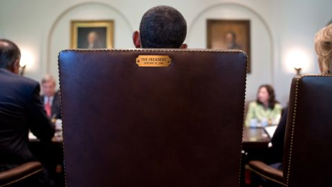 """Obama sits in his chair during a Cabinet meeting in July 2012. This image was tweeted by his official Twitter account in August 2012 in response to <a href=""""http://www.cnn.com/2012/08/31/politics/eastwood-speech/"""" target=""""_blank"""">Clint Eastwood's """"empty chair"""" speech</a> at the Republican National Convention. The tweet simply said, """"This seat's taken."""""""