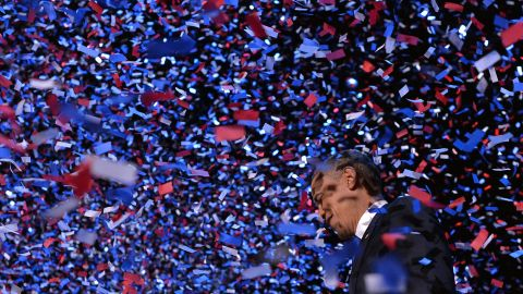 Obama celebrates on stage in Chicago after defeating Romney on Election Day in 2012.