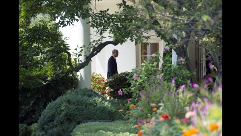 Obama walks to the Oval Office on August 7, 2014, the same day he announced the beginning of airstrikes on ISIS.