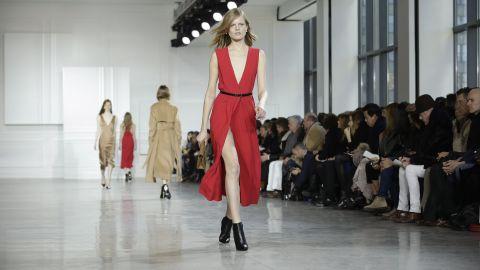 Model Hanne Gaby Odiele walks for Jason Wu in a seductive silk dress with a thigh-high slit.