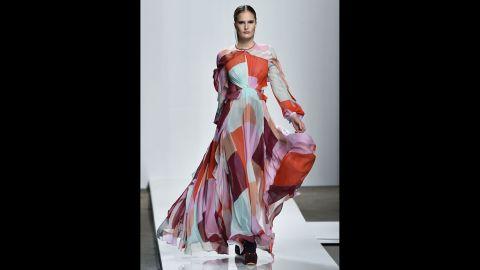 A model walks in a geo-patterned maxi dress for Australian label Zimmermann.