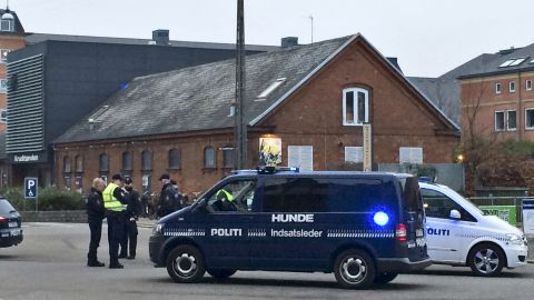 """Emergency services gather outside a venue after shots were fired where an event titled """"Art, blasphemy and the freedom of expression"""" was being held in Copenhagen, Saturday, February 14. D"""
