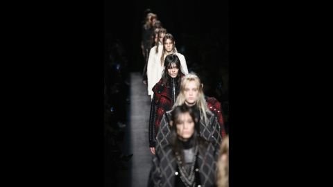 Taking a break from the season's 1970s theme, models stomp down the runway in heavy-metal hair and makeup for Alexander Wang's edgy fall collection.