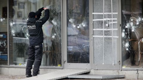 A police investigator works at the scene of Saturday's shooting at a free speech event in Copenhagen, on February 15.