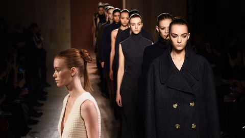 A model presents a boxy outerwear look by designer Victoria Beckham.