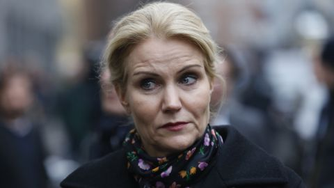 Dansh Prime Minister Helle Thorning-Schmidt pays respects Sunday Feb. 15, 2015, at the Copenhagen Synagogue for the victims for the Saturday night's shootings in Copenhagen. Danish police shot and killed a man early Sunday suspected of carrying out shooting attacks at a free speech event and then at a Copenhagen synagogue, killing two men, including a member of Denmark's Jewish community. Five police officers were also wounded in the attacks. (AP Photo / Thomas Borberg, Polfoto)