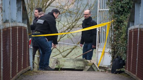 Police on Monday, February 16, inspect the scene where hundreds of Jewish graves were defaced at a cemetery in Sarre-Union, France.