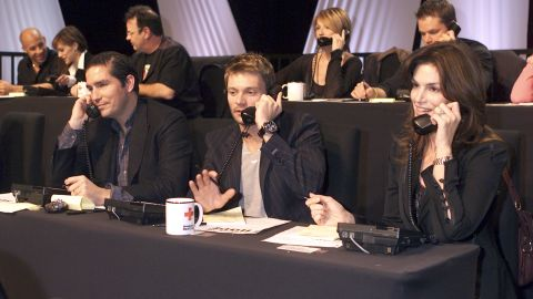 """Jim Caviezel, left, Ryan Seacrest and Crawford take calls during the """"Tsunami Aid: A Concert of Hope"""" telethon in 2005."""