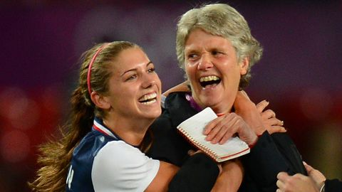Morgan celebrates with former U.S. coach Pia Sundhage after her winning goal had given the Americans a 4-3 win over Canada at the semifinal stage of London 2012. Sundhage, now coach of her native Sweden, guided the USWNT to successive Olympic gold medals.