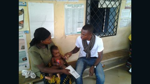 Cameroonian entrepreneur Alain Nteff, seen in this picture with a mother and her baby, is the founder of a startup is fighting to eradicate maternal and infant mortality across the country.
