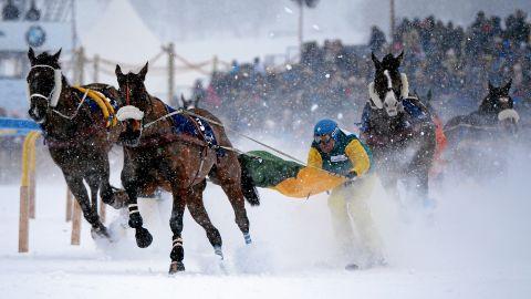 Franco Moro marginally leads the field in a skijoring race in St Moritz.