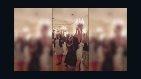 pkg woman catches 46 weddint bouquets_00010505.jpg