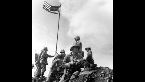 Marine Sgt. Louis Lowery, a photographer for Leatherneck magazine, captured this image of Marines raising an American flag for the first time atop Iwo Jima's Mount Suribachi on February 23, 1945. A strange series of events, however, made this photo less well-known than Rosenthal's.