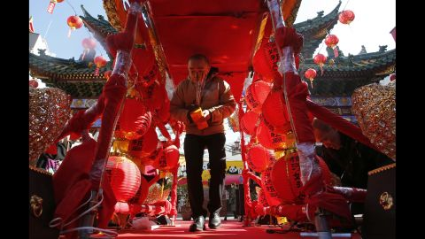 A man walks through red lantern decorations at a temple near Tokyo on February 19.
