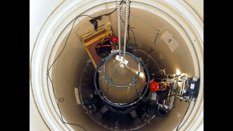 """In this undated image released by the U.S. Air Force, a maintenance team from Montana's Malmstrom Air Force Base removes the upper section of an intercontinental ballistic missile. Missile launch officers at the base's Global Strike Command were recently caught <a href=""""http://www.cnn.com/2014/03/27/us/air-force-cheating-investigation/"""" target=""""_blank"""">cheating on proficiency exams.</a>"""
