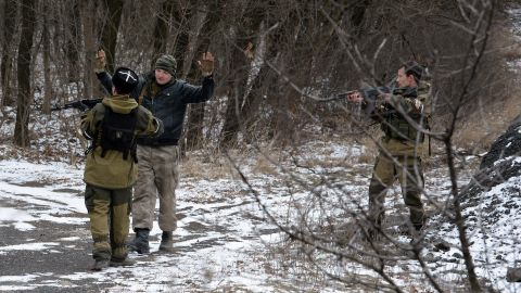 Two pro-Russian seperatists stop a man in the eastern Ukrainian city of Uglegorsk in 2015.