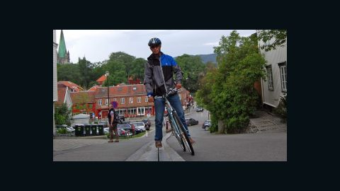 """The Trampe bicycle lift has been in existence for more than 20 years but was recently rebuilt as the new and improved """"CycloCable."""" Using ski-lift technology, cyclists put their right foot on a traveling plate that tows the rider up a 130 meter hill with a gradient of 1:5."""