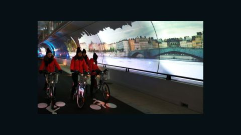 """Lyon, France's second city, has its own bike share scheme """"Velo'v"""" to rival the """"Velib"""" system of its big sister Paris. But Paris does not have Lyon's """"Le Tube"""" - a 2km car-free route that doubles as a continuous art installation with projected images."""