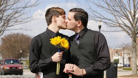 Justin Lewis and Shawn Williams share a kiss after their wedding this month in Alabama.