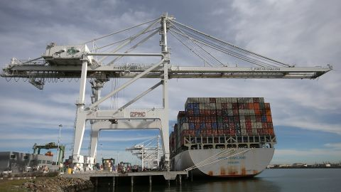 A container ship sits docked in a berth at the Port of Oakland last week.