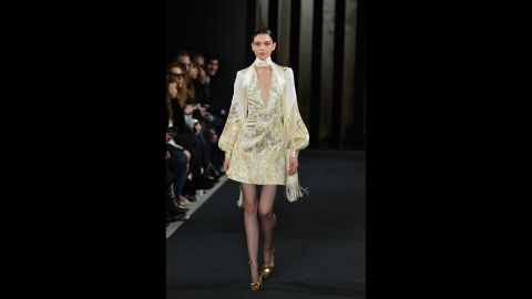 """J. Mendel's collection embraced fall's <a href=""""http://www.cnn.com/2015/02/13/living/feat-nyfw-fall-2015-forecast/"""">1970s trend</a> with skinny scarves and gold jacquard."""
